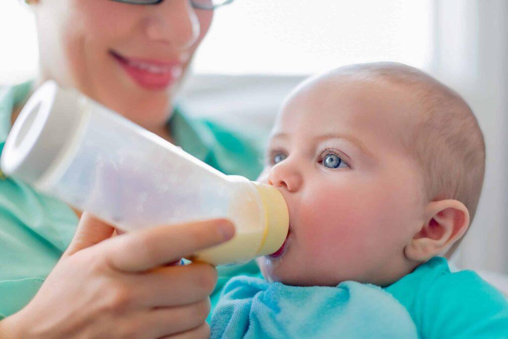 bottle feeding baby using paced feeding